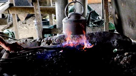 Traditional blacksmith heating iron in the fire 影像素材