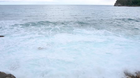 boulders : Blue sea waves at cloudy weather Stock Footage