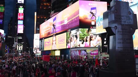 times : NEW YORK, USA - OCTOBER 20, 2018: Times Square at night.Cars riding and pedestrians walk on Times Square, downtown Manhattan. Famous street of New York City.