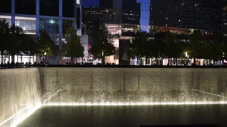 eleven people : NEW YORK, USA - OCTOBER 20, 2018: Reflecting Pool at New Yorks 911 Memorial at Ground Zero