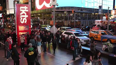 NEW YORK, USA - OCTOBER 20, 2018: Times Square at night.Cars riding and pedestrians walk on Times Square, downtown Manhattan. Famous street of New York City.