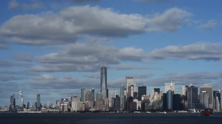 Skyline with famous skyscrapers of Manhattan and East River at sunset. Water tour to the island of Liberty. 影像素材
