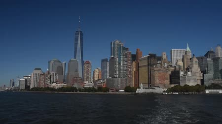 Skyline with famous skyscrapers of Manhattan and East River. Water tour to the island of Liberty.