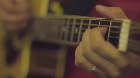 playing band : Close up - hands playing the acoustic guitar