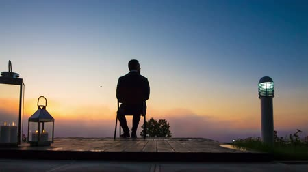 olhares : businessman in the morning on the terrace admiring the sunrise