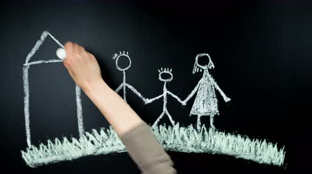 tablica : Family. The hand draws by chalk on a board