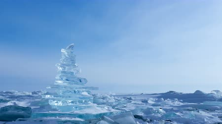 frozen lake : Winter Landscape. Crystal clear ice chunks. Pyramid of clear ice of Lake Baikal