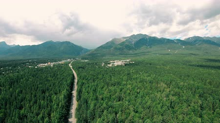 bulutluluk : Dramatic aerial view of mountains, dark green forest landscape, road and town