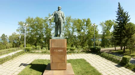 propaganda : Aerial view of Lenin Statue Monument. Unique cityscape. Irkutsk Russia. Travel Sights Landmark. Drone rise up Stock Footage