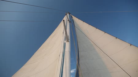 stožár : yacht sailboat developing in the wind on blue sky background