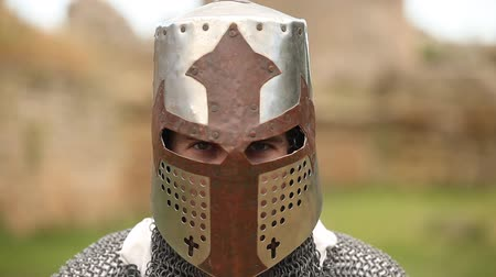 armed knight with in helmet looking in camera Stok Video