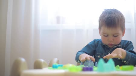 blurring : The child plays with kinetic sand and develops motor skills Stock Footage