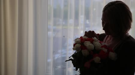 without face : The girl was given a large bouquet of roses, silhouette, gift