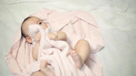 shower room : Newborn beautiful baby in towel after bathing