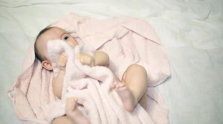 very : Newborn beautiful babe in towel after bathing Stock Footage