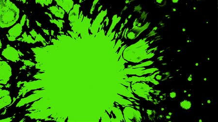 splashed : Effect with a drop of bright green paint on the water surface