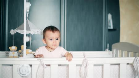 kap : Little girl crying standing in a baby cot HD 1080p