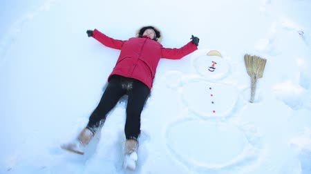 gag : Girl kidding fell in the snow next to a snowman HD