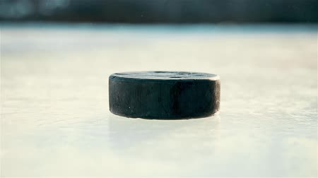bab : The approach of the black hockey puck on the ice 1080p Stock mozgókép