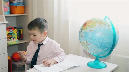 doesnt : Little boy does not want to learn and study the world map HD 1080