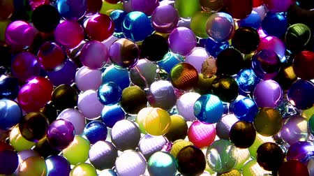 абсорбент : Decorative multicolored balls Shine under the action of light 1080p HD Стоковые видеозаписи