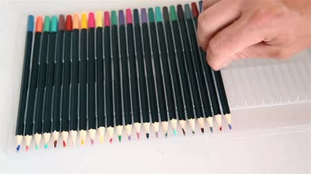 sharpened : Sharpened colored pencils sorts man 1920x1080 Stock Footage