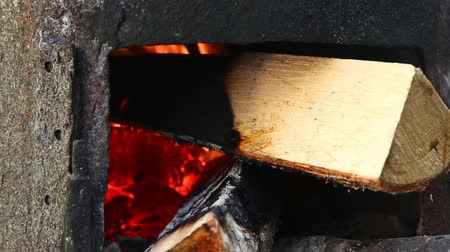 kuchenka : In the village outdoors in the stove slowly burning wood closeup HD 1920x1080
