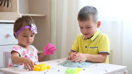kinetik : Children in a childrens institution play together with kinetic sand