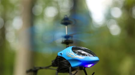 tartmak : Small helicopter in the forest outdoors hovering in the air HD 1080