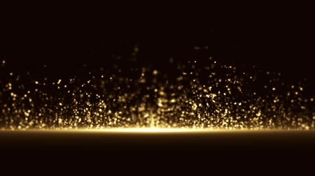 lasca : Slow motion explosion of small round shaped fragments of gold color on a black background HD