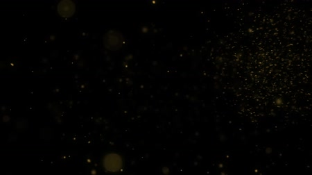 Animation of fine dust particles of Golden color on the surface on a black background HD 1920X1080