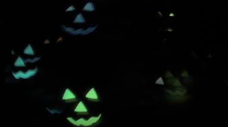 резной : Animation of flashing flying multicolored pumpkins on a black background HD