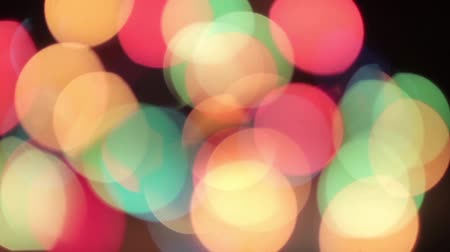Flying defocused multicolored circles on a black background HD 1920x1080 Stock Footage