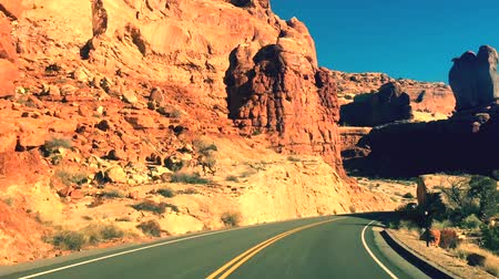 The typical American road in the Arches National Park, Utah, USA