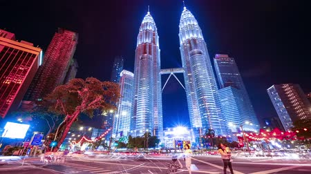 Timelapse of a crossroad in front of the Petronas Tower at night, Kuala Lumpur, Malaysia. Stock Footage