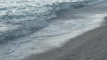 Slow motion video of Sea waves crashing on a white sand beach