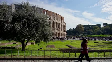 People walking around the Coliseum in a sunny day. Rome, Italy.