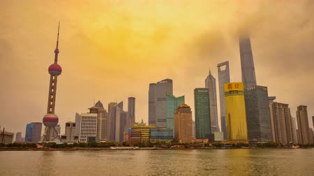 Timelapse of the Shanghai Skyline in a cloudy day at sunrise, China.