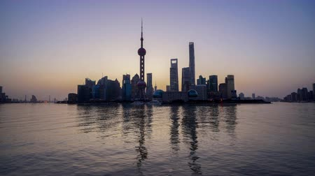 tv tower : Timelapse of the Shanghai Skyline at sunrise reflected on Huangpu river, China.