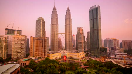 City skyline time lapse, with the Petronas Twin Towers and the KLCC park. Malaysia