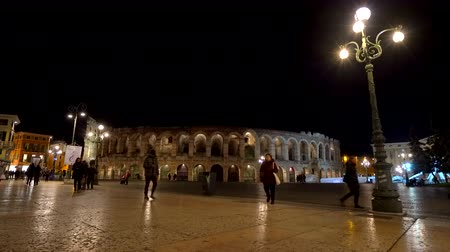 People walking in front of the Veronas Arena at night, Verona, Italy. Stock Footage