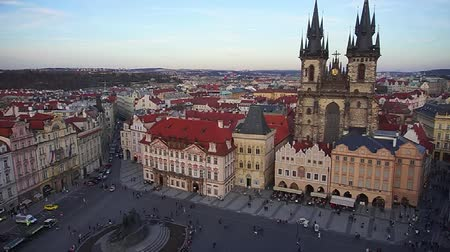 Prague, aerial view of people walking on Old Town Square, view of the beautiful Tyn Church. Czech Republic