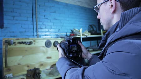 pans : Young professional male photographer making a photo shoot for photo stocks during the cold season, a manufacturing company