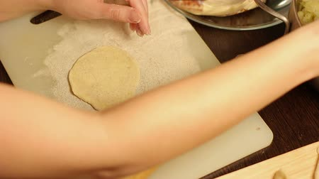 pastry : Woman hands preparing homemade pastries, she uses the flour, cutting board, rolling pin and knife.It looks delicious and homemade.