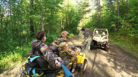 atv : Two Man on ATV in a forest video Selfe