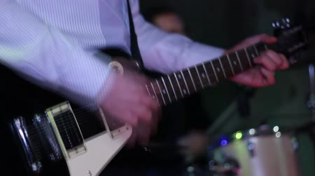 playing band : Man playing electric guitar in rock band, night club, pub