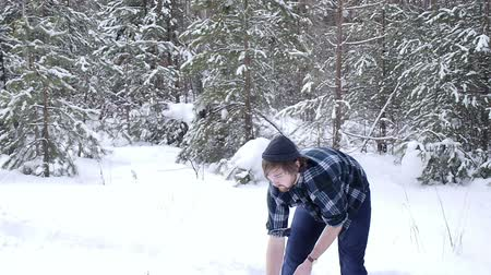 beardie : Lumberjack chopping ax to cut firewood in the winter forest