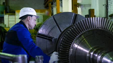 production tool : lathe operator in a factory for the production repair rotor for compressor turbine