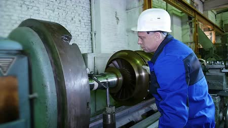 industry : lathe operator in a factory for the production repair rotor for compressor turbine