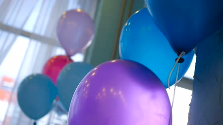 item : Slow motion colour balloons in room